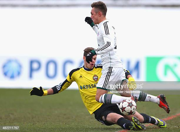 Oliver Markoutz of Bayern Muenchen battles for the ball with Ilya Pomazun, keeper of Moscow during the UEFA Youth League match between CSKA MOscow...