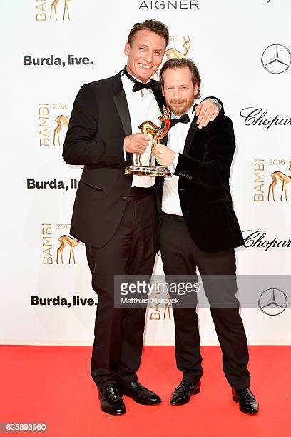 Oliver Masucci and Fabian Busch pose with award at the Bambi Awards 2016 winners board at Stage Theater on November 17, 2016 in Berlin, Germany.