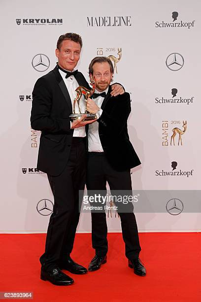 Oliver Masucci and Fabian Busch pose with award at the Bambi Awards 2016 winners board at Stage Theater on November 17 2016 in Berlin Germany