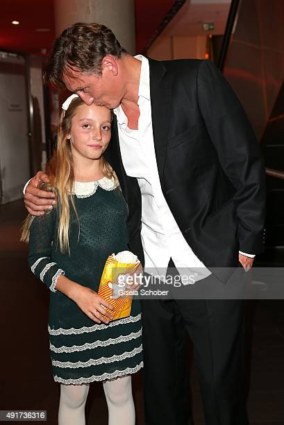Oliver Masucci and his daughter Milla Masucci during the special screening of the film 'Er ist wieder da' at Mathaeser Filmpalast on October 7, 2015...
