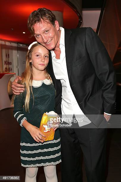 Oliver Masucci and his daughter Milla Masucci during the special screening of the film 'Er ist wieder da' at Mathaeser Filmpalast on October 7 2015...