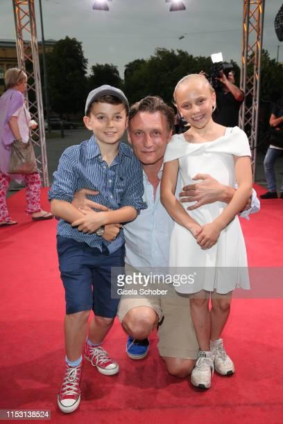 """Oliver Masucci and his son Vito Masucci and his daughter Pina Masucci during the """"Schuld nach Ferdinand von Schirach"""" season 3 premiere at the Munich..."""