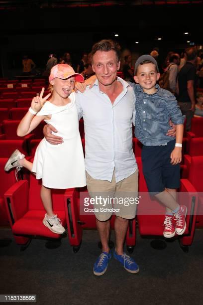 Oliver Masucci and his son Vito Masucci and his daughter Pina Masucci during the Schuld nach Ferdinand von Schirach season 3 premiere at the Munich...