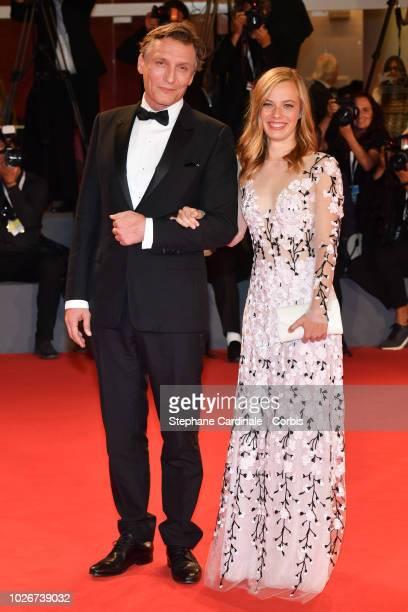 Oliver Masucci and Saskia Rosendahl walk the red carpet ahead of the 'Werk Ohne Autor ' screening during the 75th Venice Film Festival at Sala Grande...
