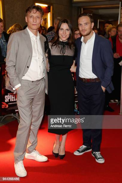 Oliver Masucci, Antje Traue and Frederick Lau attend 'Spielmacher' Premiere at Lichtburg on April 10, 2018 in Essen, Germany.