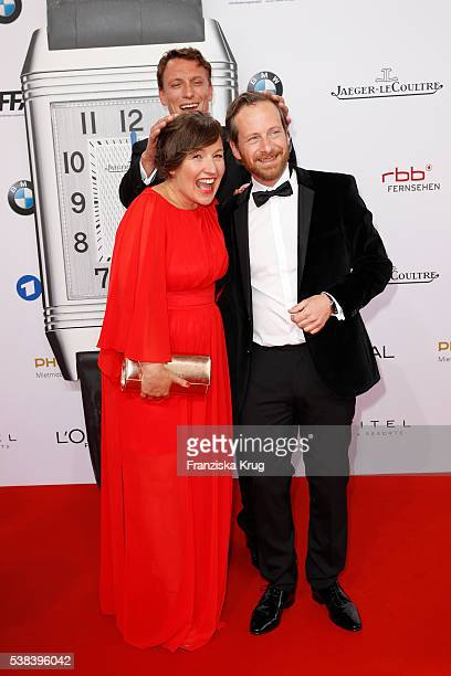 Oliver Masucci, Fabian Busch and his wife Sunny Scheucher during the Lola German Film Award 2016 on May 27, 2016 in Berlin, Germany.