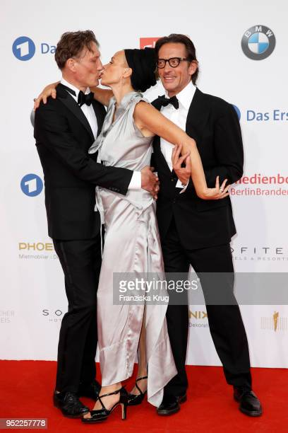 Oliver Masucci, Katja Riemann and Oskar Roehler attend the Lola - German Film Award red carpet at Messe Berlin on April 27, 2018 in Berlin, Germany.