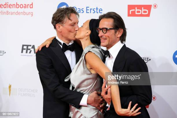 Oliver Masucci Oskar Roehler and Katja Riemann attend the Lola German Film Award red carpet at Messe Berlin on April 27 2018 in Berlin Germany