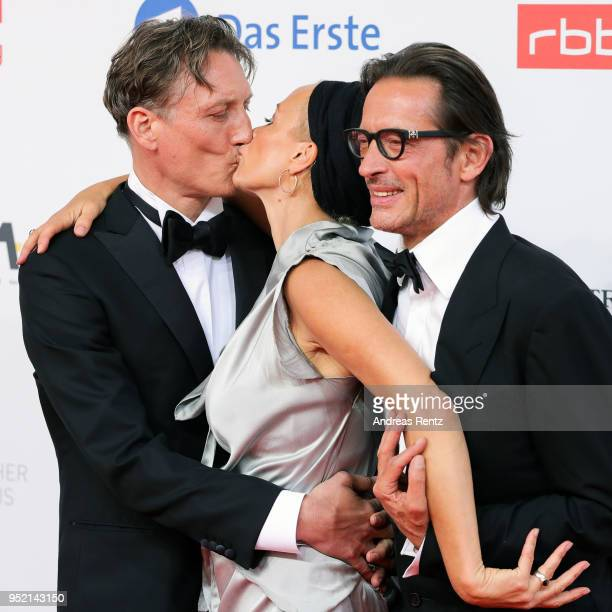 Oliver Masucci, Oskar Roehler and Katja Riemann attend the Lola - German Film Award red carpet at Messe Berlin on April 27, 2018 in Berlin, Germany.