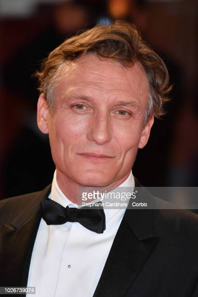 Oliver Masucci walks the red carpet ahead of the 'Werk Ohne Autor ' screening during the 75th Venice Film Festival at Sala Grande on September 4,...