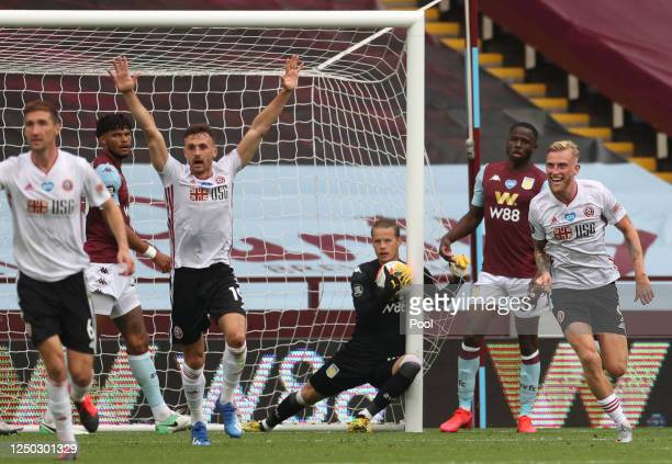 Oliver McBurnie and Jack Robinson of Sheffield United appeal for a goal which is later denied as Orjan Nyland of Aston Villa catches the ball during...