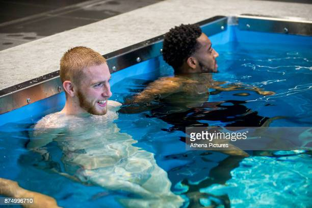 Oliver McBurnie and Leroy Fer exercise in the pool during the Swansea City training session at The Fairwood training Ground on November 16 2017 in...