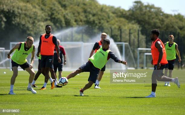 Oliver McBurnie Kyle Bartley Jefferson Montero and Wayne Routledge in action during the Swansea City Training at The Fairwood Training Ground on July...