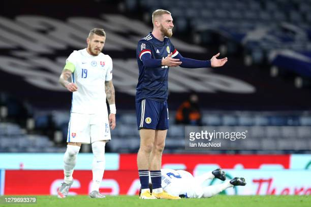 Oliver McBurnie of Scotland reacts being shown the yellow card during the UEFA Nations League group stage match between Scotland and Slovakia at...