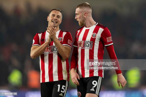 Oliver McBurnie of Sheffield United and Phil Jagielka of Sheffield United applaud the home fans after the Premier League match between Sheffield...
