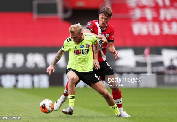 Oliver McBurnie of Sheffield United battles for possession with Jannik Vestergaard of Southampton during the Premier League match between Southampton...