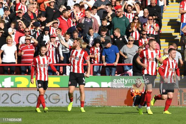 Oliver McBurnie of Sheffield United celebrates after scoring a goal which is then disallowed for offside following a VAR review during the Premier...