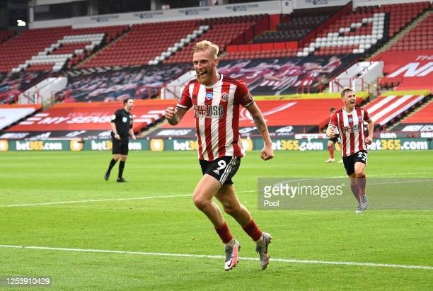 Oliver McBurnie of Sheffield United celebrates after scoring his team's third goal during the Premier League match between Sheffield United and...