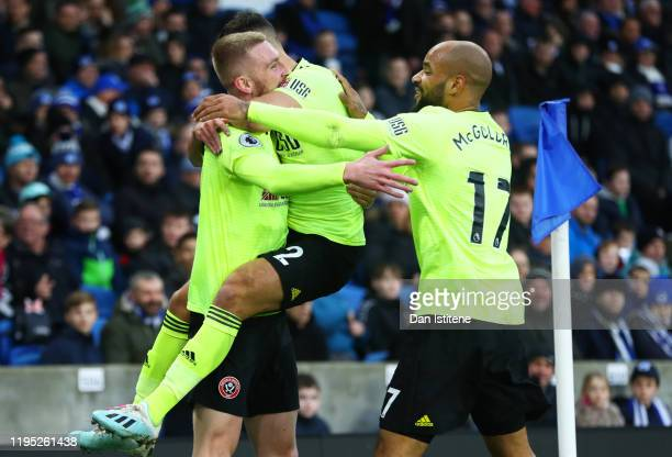 Oliver McBurnie of Sheffield United celebrates scoring the opening goal with team-mates George Baldock and David McGoldrick during the Premier League...