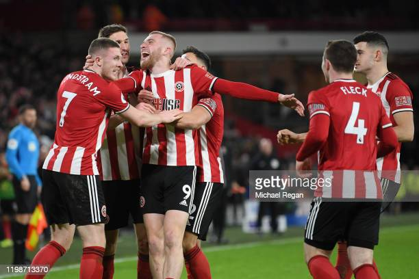 Oliver McBurnie of Sheffield United celebrates with his team after he scores his sides first goal during the Premier League match between Sheffield...