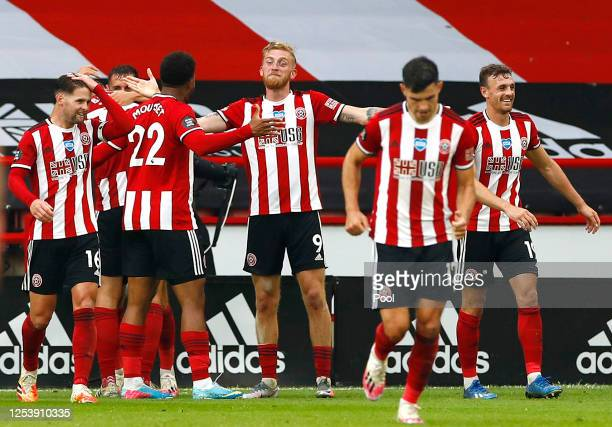 Oliver McBurnie of Sheffield United celebrates with his team mates after scoring his team's third goal during the Premier League match between...