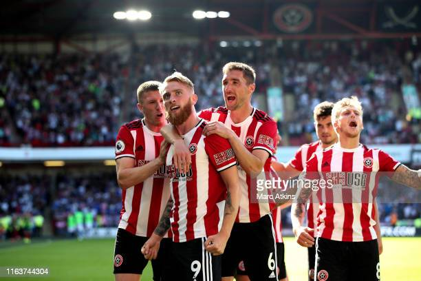 Oliver McBurnie of Sheffield United celibates his goal among team mates during the Premier League match between Sheffield United and Leicester City...