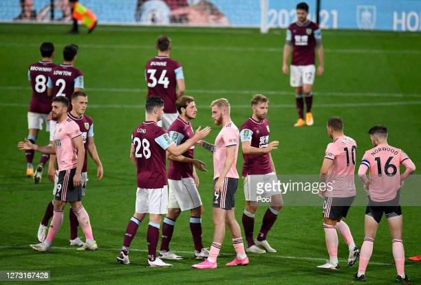 Oliver McBurnie of Sheffield United is consoled by Burnley players following his sides defeat in the Carabao Cup second round match between Burnley...