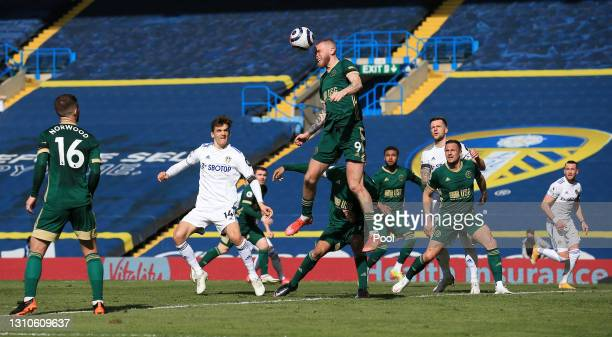 Oliver McBurnie of Sheffield United jumps for the ball during the Premier League match between Leeds United and Sheffield United at Elland Road on...