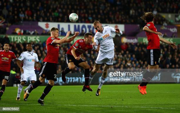 Oliver McBurnie of Swansea City Ander Herrera of Manchester United and Scott McTominay of Manchester United in action during the Carabao Cup Fourth...