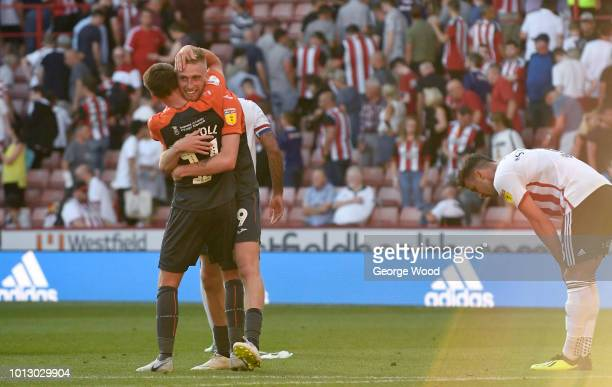 Oliver McBurnie of Swansea City celebrates scoring his sides opening goal to make score 11 with Tom Carroll during the Sky Bet Championship between...