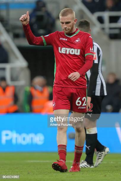 Oliver McBurnie of Swansea City gives a thumbs up to a team mate during the Premier League match between Newcastle United and Swansea City at St...