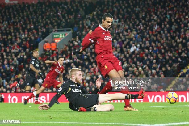 Oliver McBurnie of Swansea City has a shot on goal whilst marked by Jol Matip of Liverpool during the Premier League match between Liverpool and...