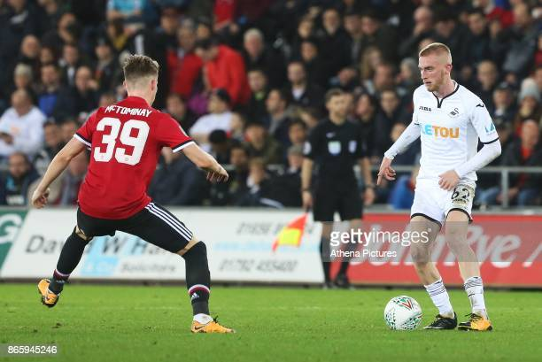 Oliver McBurnie of Swansea City is marked by Scott McTominay of Manchester United during the Carabao Cup Fourth Round match between Swansea City and...
