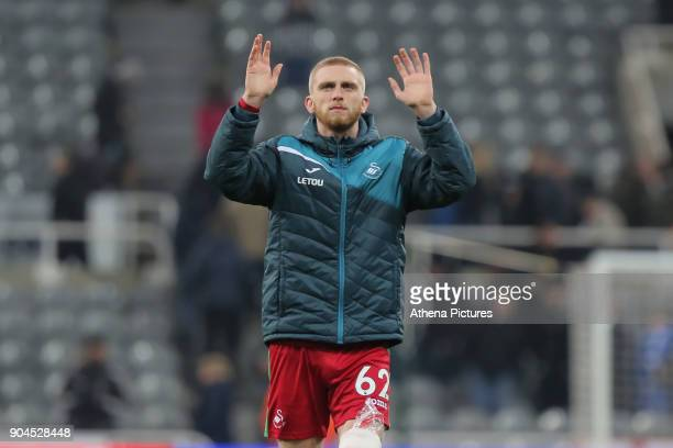 Oliver McBurnie of Swansea City thanks away supporters at the end of the game during the Premier League match between Newcastle United and Swansea...