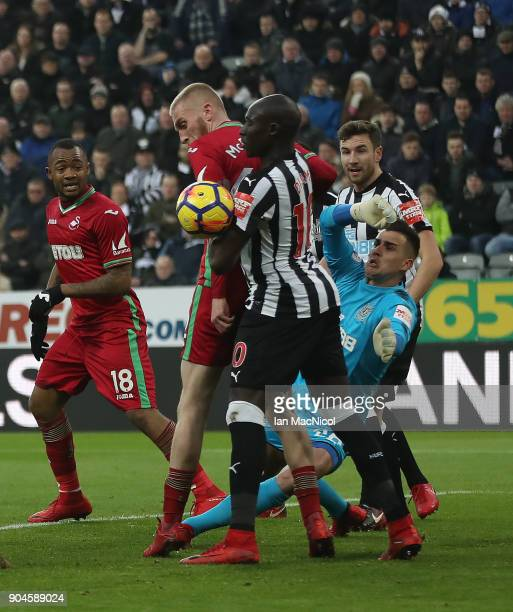 Oliver McBurnie of Swansea City vies with Mohamed Diame of Newcastle United during the Premier League match between Newcastle United and Swansea City...