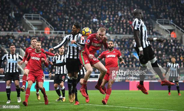 Oliver McBurnie of Swansea City wins a header over Ayoze Perez of Newcastle United during the Premier League match between Newcastle United and...