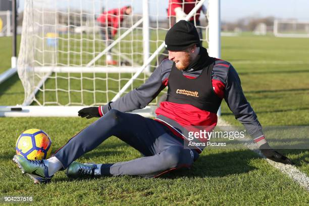Oliver McBurnie slides on the pitch during the Swansea City Training at The Fairwood Training Ground on January 11 2018 in Swansea Wales