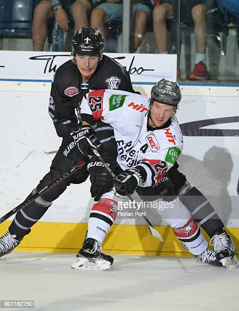 Oliver Mebus of Thomas Sabo Ice Tigers Nuremberg and Patrick Hager of Koelner Haie during the test match between Thomas Sabo Ice Tigers Nuremberg and...