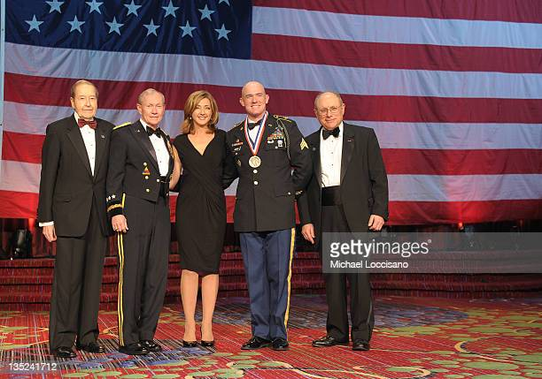 Oliver Mendell Martin E Dempsey Chris Jansing Soldier of the year Ty Carter and Myron Berman pose onstage at the 50th USO Armed Forces gala Gold...