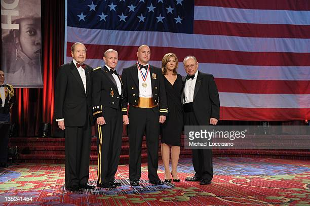 Oliver Mendell Martin E Dempsey Jason Moritz Chris Jansing and Myron Berman pose onstage at the 50th USO Armed Forces gala Gold Medal dinner at The...