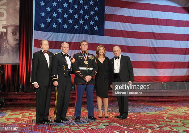 Oliver Mendell Martin E Dempsey Marine of the year Dakota Meyer Chris Jansing and Myron Berman pose onstage at the 50th USO Armed Forces gala Gold...