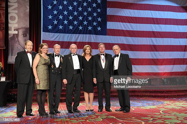 Oliver Mendell Patricia Parry Martin E Dempsey Mike Parry Chris Jansing Scott Bill and Myron Berman pose onstage as the award for Sailor of the year...