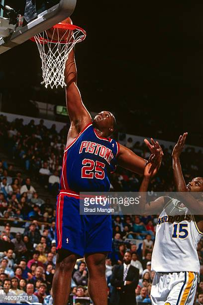 Oliver Miller of the Detroit Pistons dunks during a game played circa 1995 at the Oakland Coliseum in Oakland California NOTE TO USER User expressly...