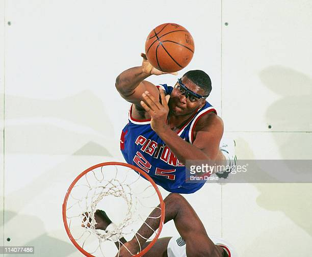 Oliver Miller of the Detroit Pistons shoots against the Portland Trailblazers at the Veterans Memorial Coliseum in Portland Oregon circa 1994 NOTE TO...