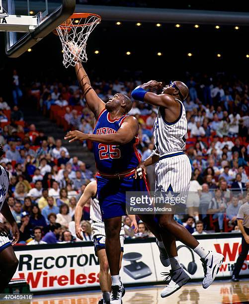 Oliver Miller of the Detroit Pistons shoots the ball against the Orlando Magic on April 5 1995 at the Orlando Arena in Orlando Florida NOTE TO USER...