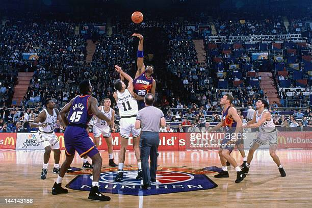 Oliver Miller of the Phoenix Suns battles for the jumpball against Buckler Bologna as part of the 1993 McDonald's Championships on October 23 1993 at...