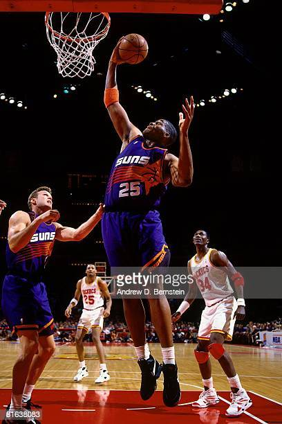 Oliver Miller of the Phoenix Suns grabs a rebound in Game One of the Western Conference Semifinals against the Houston Rockets during the 1994 NBA...