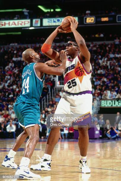 Oliver Miller of the Phoenix Suns handles the ball during a game on January 11 1994 at America West Arena in Phoenix Arizona NOTE TO USER User...