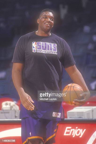 Oliver Miller of the Phoenix Suns looks on before basketball game against the Washington Bullets at Capital Centre on January 22 1993 in Landover...