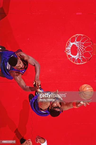 Oliver Miller of the Phoenix Suns rebounds against the Sacramento Kings circa 1993 at Arco Arena in Sacramento California NOTE TO USER User expressly...